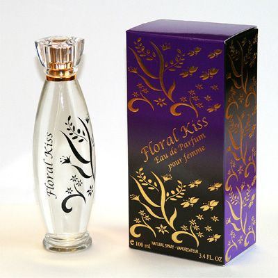 Floral Kiss is a unique creation, a warm sensual fragrance, renders the effect of sophistication and refinement. A fragrance based on the contrast between the freshness and softness of the rose, and the dark sensuality of amber, This sophisticated scent is focused on an intense sense of femininity. Designed by Canadian Designers Andrea & CS.