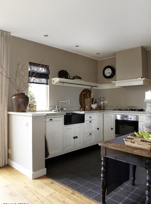 .White kitchen with grey tiles on the floor. rustic and modern mix.
