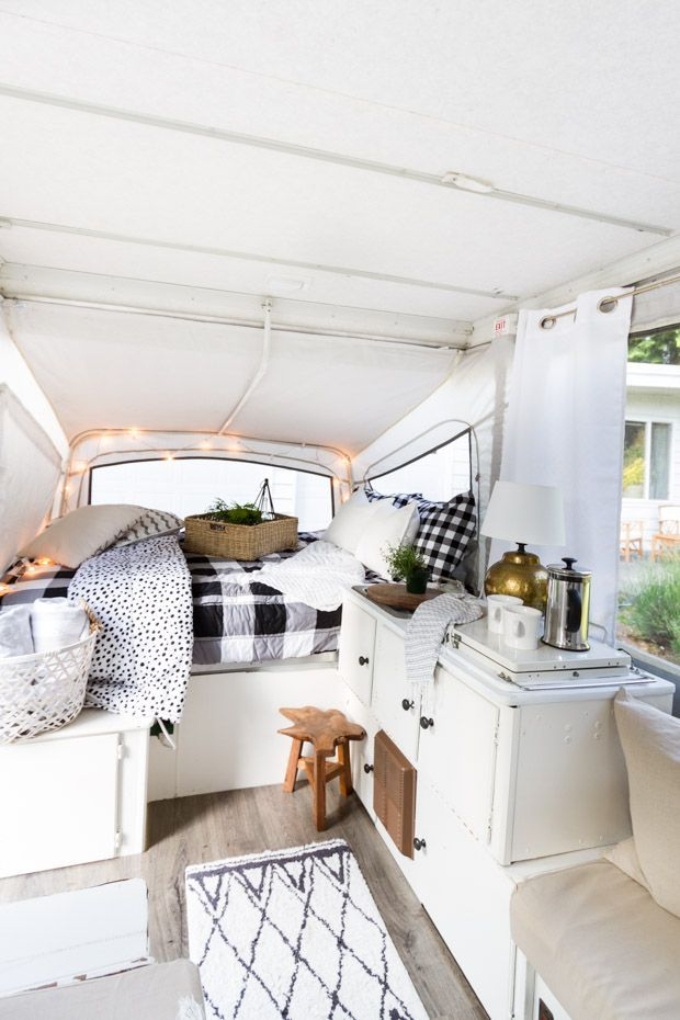 A 1990's pop-up camper freshened up with new floors, paint and some accessories.