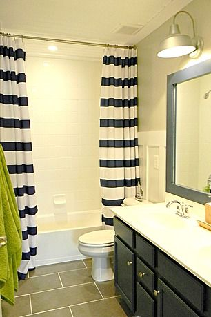 Kid's Nautical Bathroom with punches of navy and green