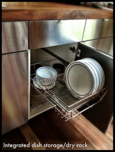 Drying rack/hidden dish storage. Saves time and keeps dishes hidden