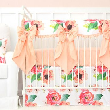This 2 pc. set features an adorable and fun coral and pink watercolor floral flat panel crib skirt with a coordinating solid coral crib sheet. This set is perfect for any boho baby girl's nursery!