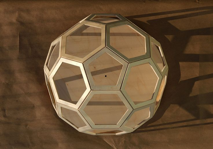 A geodesic modular bulletin board / whiteboard designed by Robin Stethem for a group project in 2013. STETHEM.COM