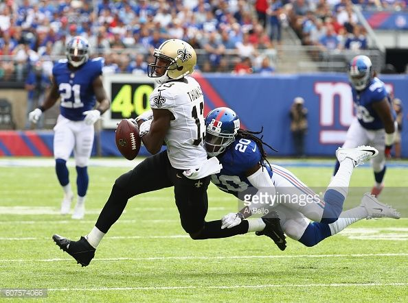 Janoris Jenkins of the New York Giants tackles Michael Thomas of the New Orleans Saints during the second half at MetLife Stadium on September 18...