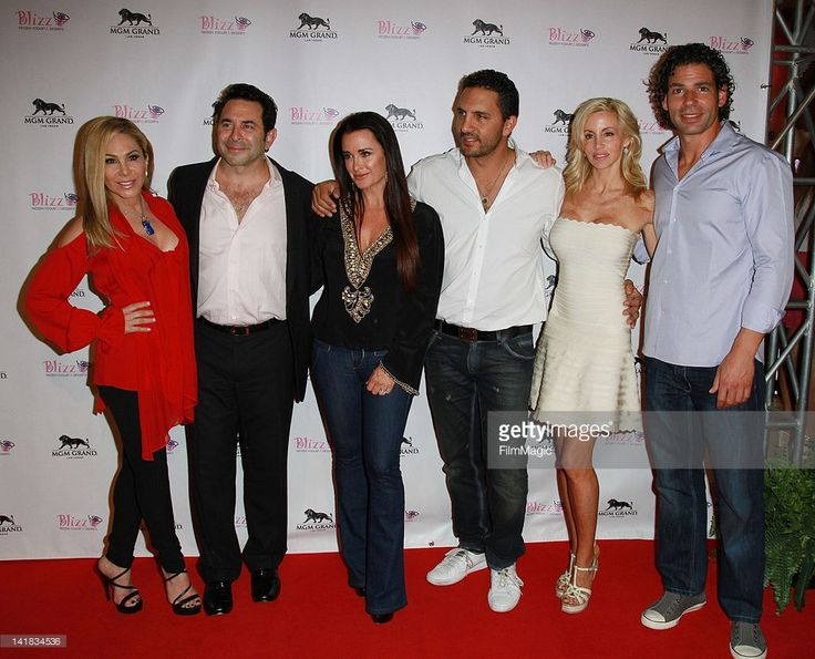 Real Housewives of Beverly Hills stars Adrienne Maloof, Paul Nassif, Kyle Richards, Mauricio Umansky, Camille Grammer and Dimitri Charalambopoulos attend the grand opening of Blizz Frozen Yogurt on March 24, 2012 in Las Vegas, Nevada.
