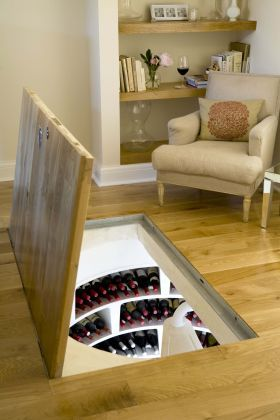 White Spiral Cellar With Recessed Trap Door from Spiral Cellars #wine  I think this would also be cool for shoes...