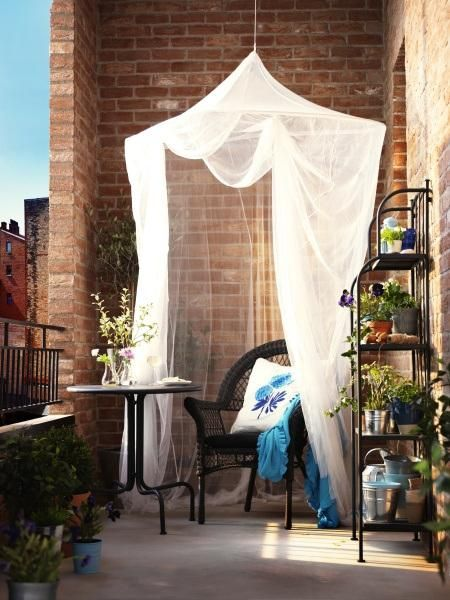 "design inspiration: small apartment balconies//Simone Design Blog IKEA has these mosquito nets, not very expensive either. A good idea if wanting to make an ""extra room!"