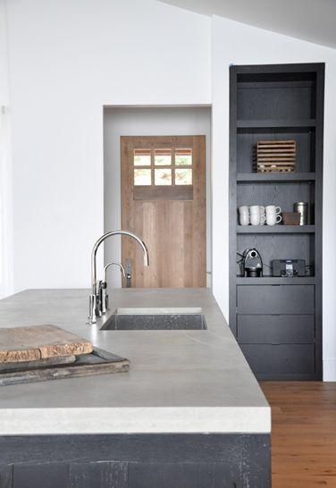 black washed cabinets Gorgeous concrete countertop and inset door with built in