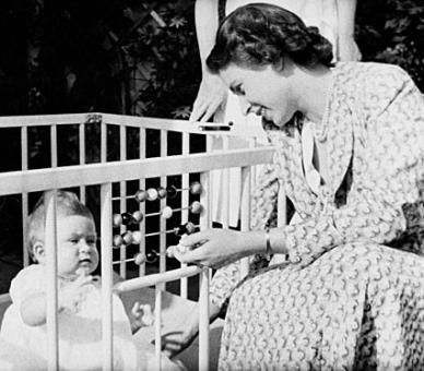 Princess Elizabeth (later The Queen) with a baby Prince Charles (later The Prince of Wales) in 1949. © PA