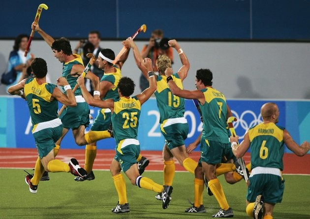 Inspirational Moments: Olympic celebrations - ATHENS - AUGUST 27: Australia celebrate their gold medal win after a Jamie Dwyer goal in extra time sealed the win in the men's field hockey event on August 27, 2004 during the Athens 2004 Summer Olympic Games at the Helliniko Olympic Complex Hockey Centre in Athens, Greece. (Photo by Clive Brunskill/Getty Images)
