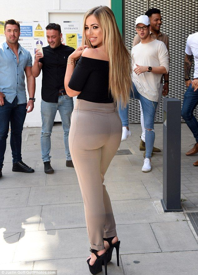 Looking good: Holly  displayed her pert posterior in a pair of figure-hugging, taupe trousers