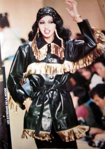 Yves Saint Laurent thinks of cowboys and proposes a jacket glazed lambskin leather fringed with gold . 1980
