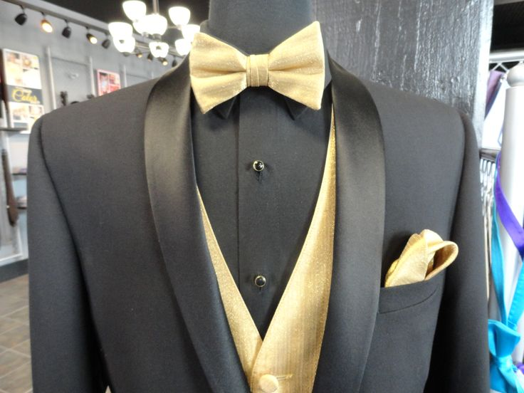 Be ready to steal any Belle away from the ball with this Black David Tutera tuxedo with our metallic gold bowtie, vest and pocket square combination.
