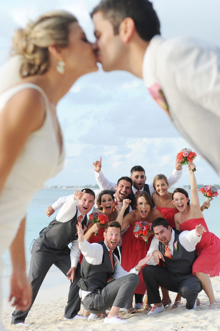 Fun and creative wedding party shot on Seven Mile Beach, Grand Cayman…