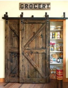 Awesome slider double barn doors on the pantry in this kitchen