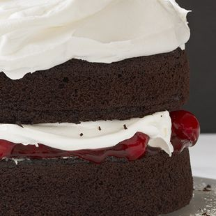 Black Forest Torte: Alternate layers of Duncan Hines Dark Chocolate Fudge Cake, red cherries and pure white whipped cream filling make this Black Forest Torte visually and taste-fully enchanting.