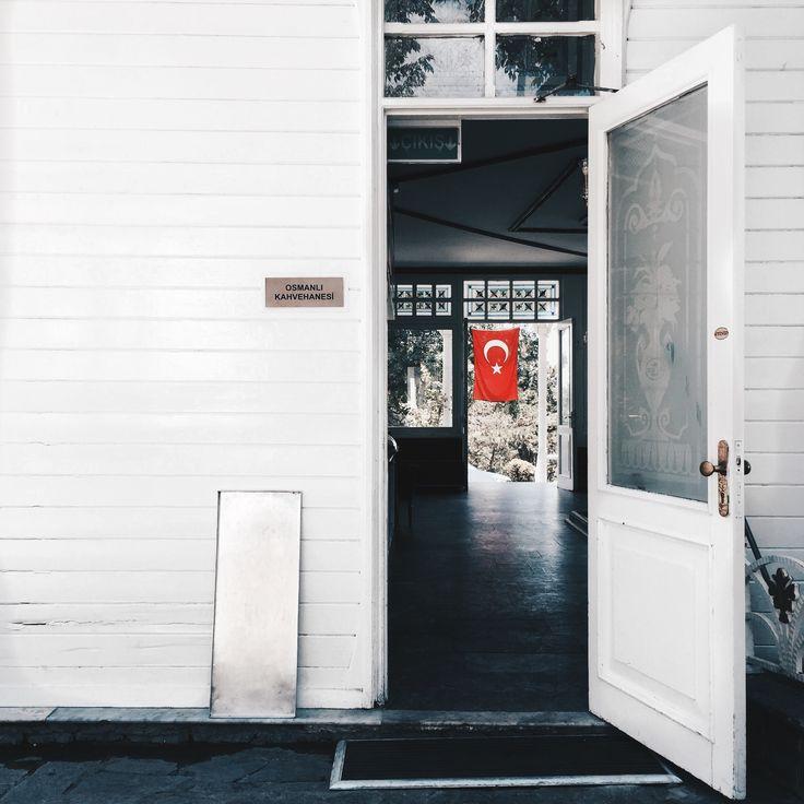 The Turkish flag through an open door.