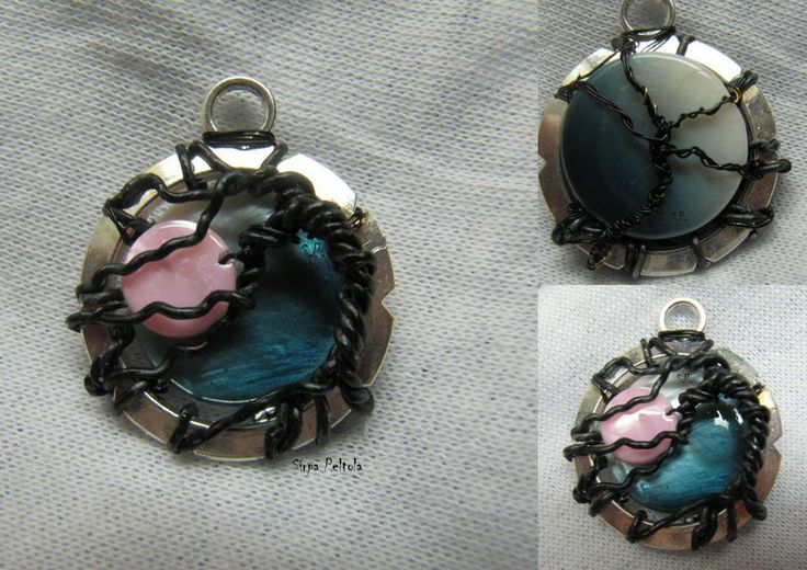 Tree Of Life- Pink Moon Black craft wire and two flat mop-beads wrapped around a pendant finding makes a interesting, darkish view.