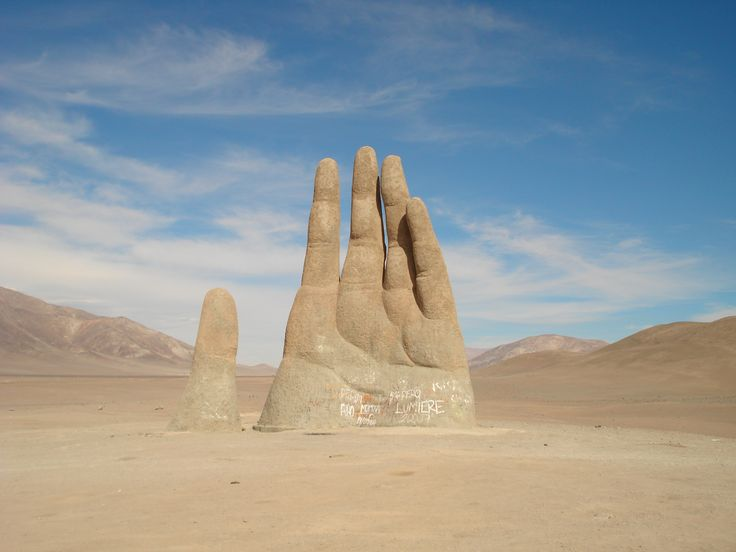 Deep in the the Atacama desert in Chile emerges a giant sculpture of a hand.