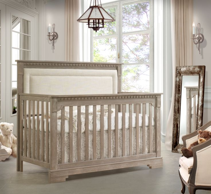 The ITHACA Convertible Crib to double, designed with a royal feel of mediterranean architecture focused on the natural beauty of raw wood to produce durable, high quality furniture.  Produced with a unique ''décapé'' finish.  Imagine an aged and silky Oak wood finish brushed to expose the natural wood grain beauty.  Available in 4 colors: Sugar Cane, Owl, Mink & White.  Sold with or without headboard upholstered panel.  Available end December 2014