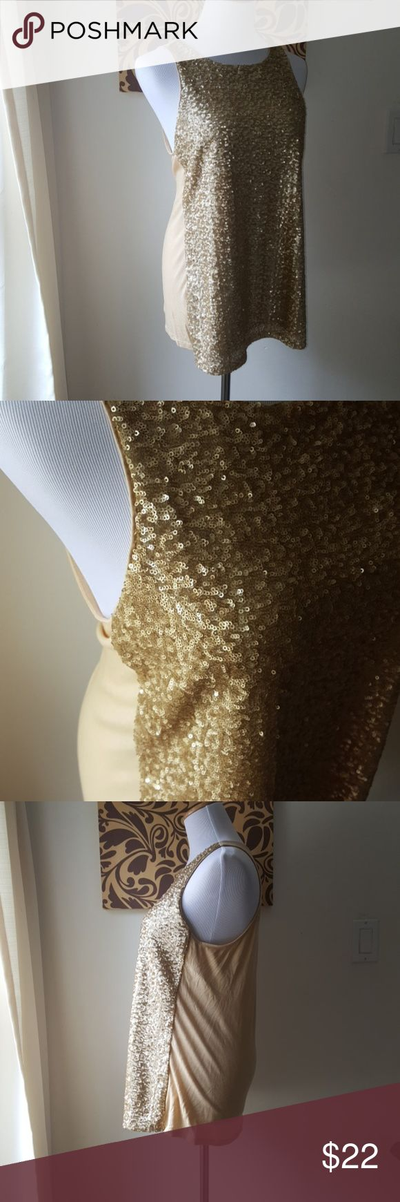 Express Gold Sequin Tank Good used condition. Gold Sequin front. The front has two layers. The bottom is a satin layer with the sequin over laying. The are not attached at bottom of short as shown in photo above. The back of shirt is a cotton blend. Great top to layer with a cardigan.  Bust: 19 inches  Length: 27.5 inches Express Tops Tank Tops