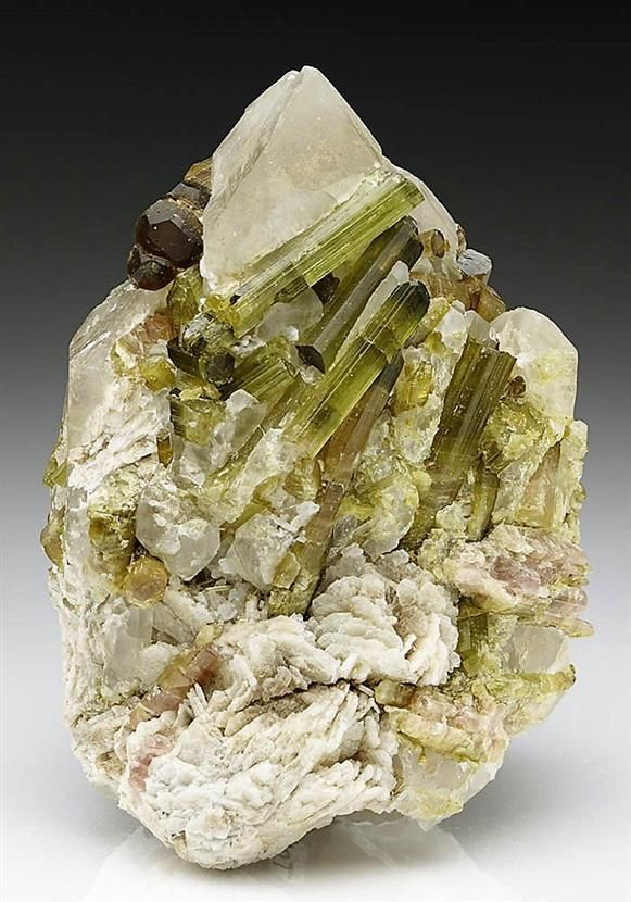 Lots of gemmy green prismatic crystals and sections of Tourmaline many with…