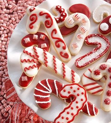 candy cane cookies. every year i try to master the royal icing cookies, maybe ill try candy canes for christmas