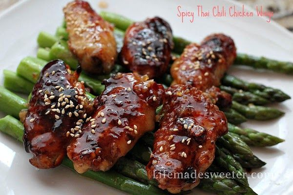 Perfectly sticky Spicy Thai Chili Chicken wings are super easy to make with the best finger lickn' good sauce!