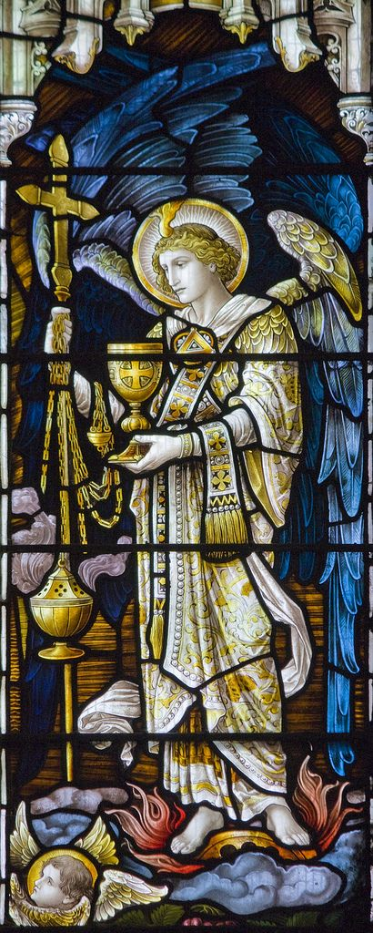 The Cup of Salvation |  Roman Canon. Detail from the east window of Holy Trinity church in Stratford-upon-Avon, showing a seraph holding the chalice of the Precious Blood of Christ.