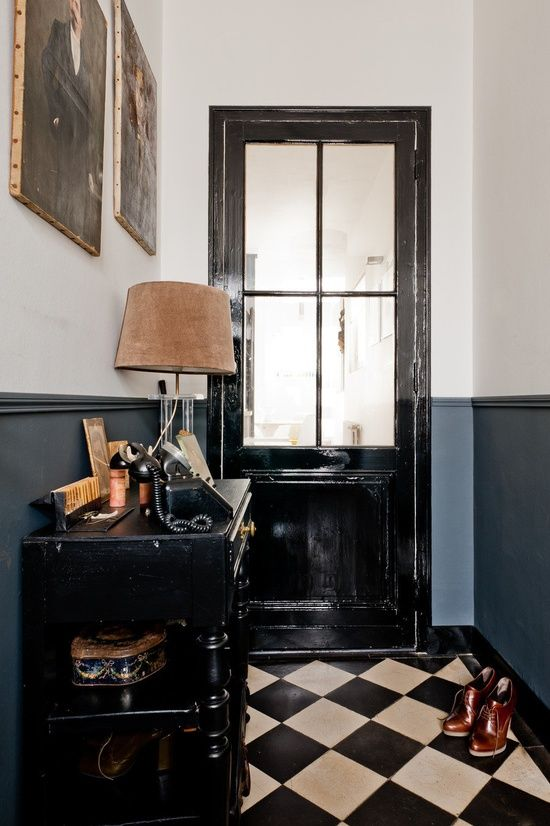I loooove this colour combination. The black and white floor and that shade of blue on the wall - with black accents