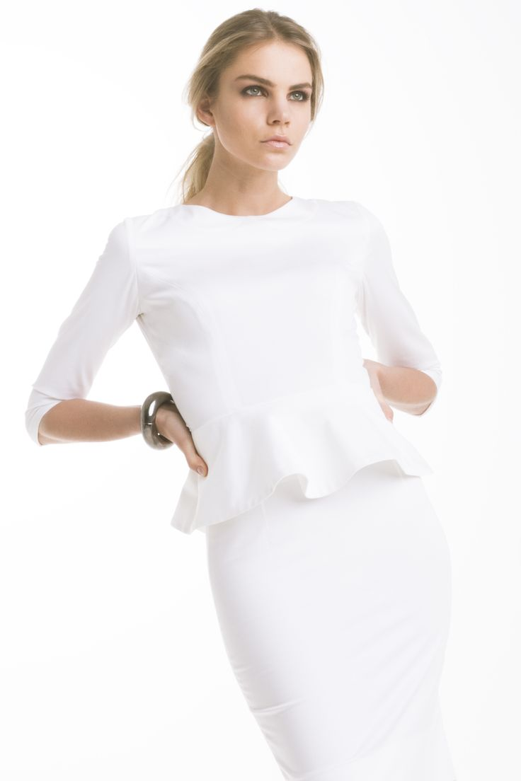 Peplum blouse by eMManuela for Maison Academia:  http://shop.maisonacademia.com/collections/spring-summer-2013/products/0015a  Pencil skirt by Ludwig ABC for Maison Academia: http://shop.maisonacademia.com/collections/spring-summer-2013/products/594g
