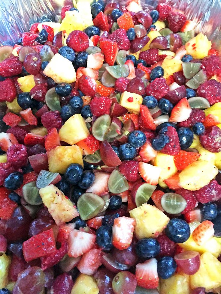 Secret Ingredient Fruit Salad combines that feature with strawberries, blueberries, raspberries, pineapple and grapes for a healthy, kid-friendly treat. | Becky's Best Bites