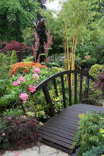 Bridge in the spring middle garden