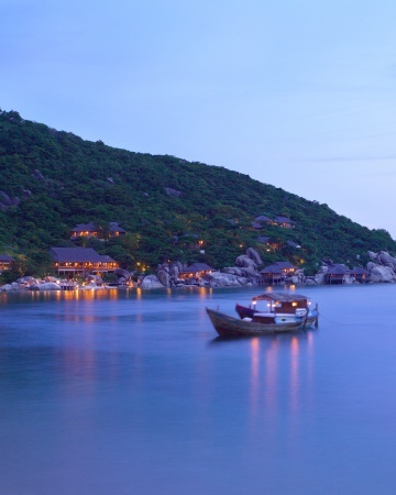 "Six Senses Ninh Van Bay (Nha Trang, Vietnam). ""Isolated on a crescent-shaped bay that's accessible only by boat, this rustic yet undeniably luxurious resort is the ultimate break from reality. We're talking villas overlooking the ocean (each has a private plunge pool), butler service (if you want it), and outstanding cuisine (perhaps a romantic dinner a deux in the Wine Cave?). For a once-in-a-lifetime experience, book a cruise on a traditional wooden boat..."""