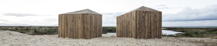 CABANAS NO RIO Perched on the tidal waters of Comporta south of Lisbon, Portugal are two small cabins. Crafted from recycled timber they reference the local fishermen's huts. The first cabin contains a bedroom and bathroom. The second a living space with basic kitchen. Simple and beautiful, romantic and at one with the wetlands. Cabanas no Rio by architect Manuel Aires Mateus. In my dreams I am there already.
