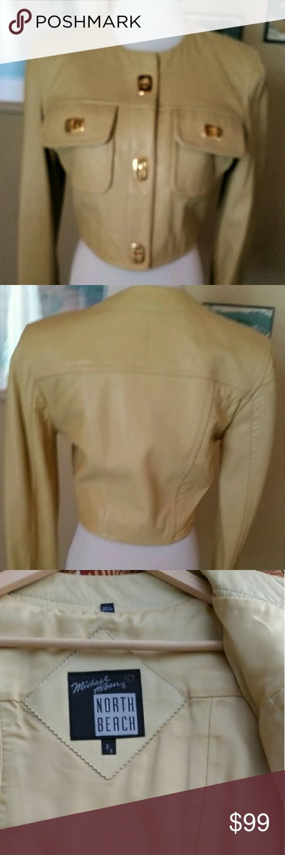 NORTH BEACH Leather Biker Jacket Ladies 3/4 Vintage Ladies 100% Leather Jacket by North Beach - Michael Hoban. This jacket is a very soft, lightweight jacket. It is fully lined in Rayon. The color is Butter Cream. It has a 3 gold metal toggles down the front, 2 toggles on the breast pockets and 2 toggles on each sleeve. It is a size 3/4. It is in perfect condition with the exception of tiny cuts on the back of the left sleeve which I had professionally repaired (See picture 4). The price has…
