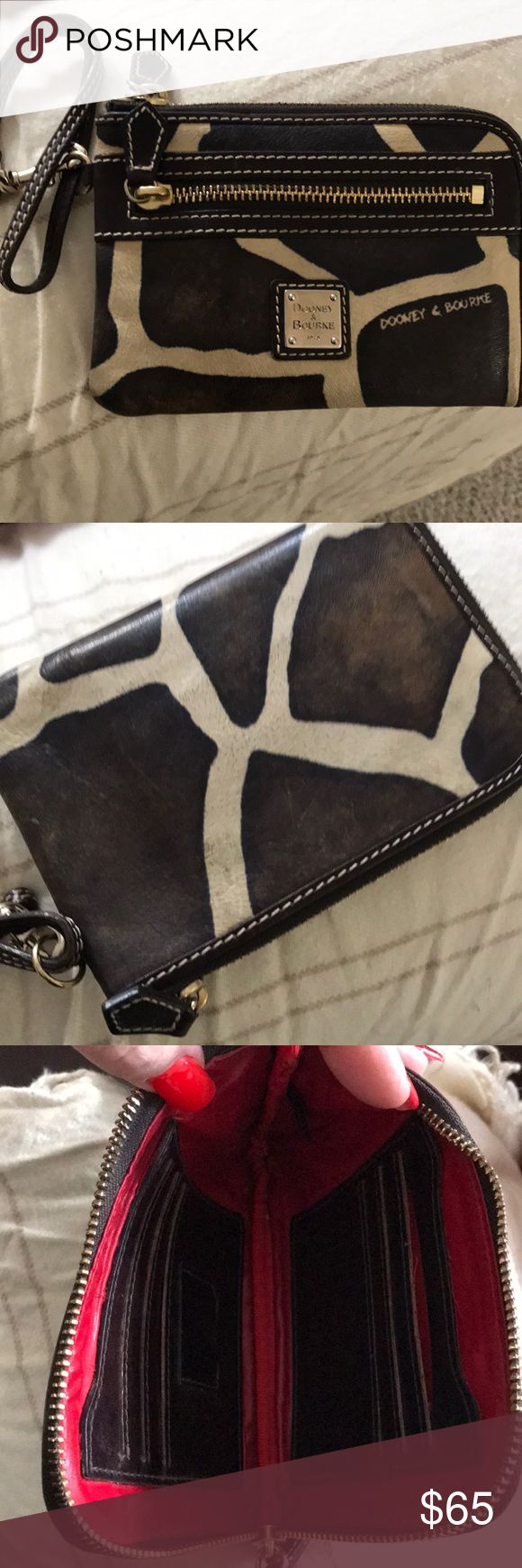 Dooney & Bourke Authentic wallet Authentic Dooney &Bourke wallet with a strap wristlet. In great condition and it matches the bag that is listed for $99. Bundle it together and I can do 20% off on both. Vintage pieces, elegant and practical! Dooney & Bourke Bags Wallets