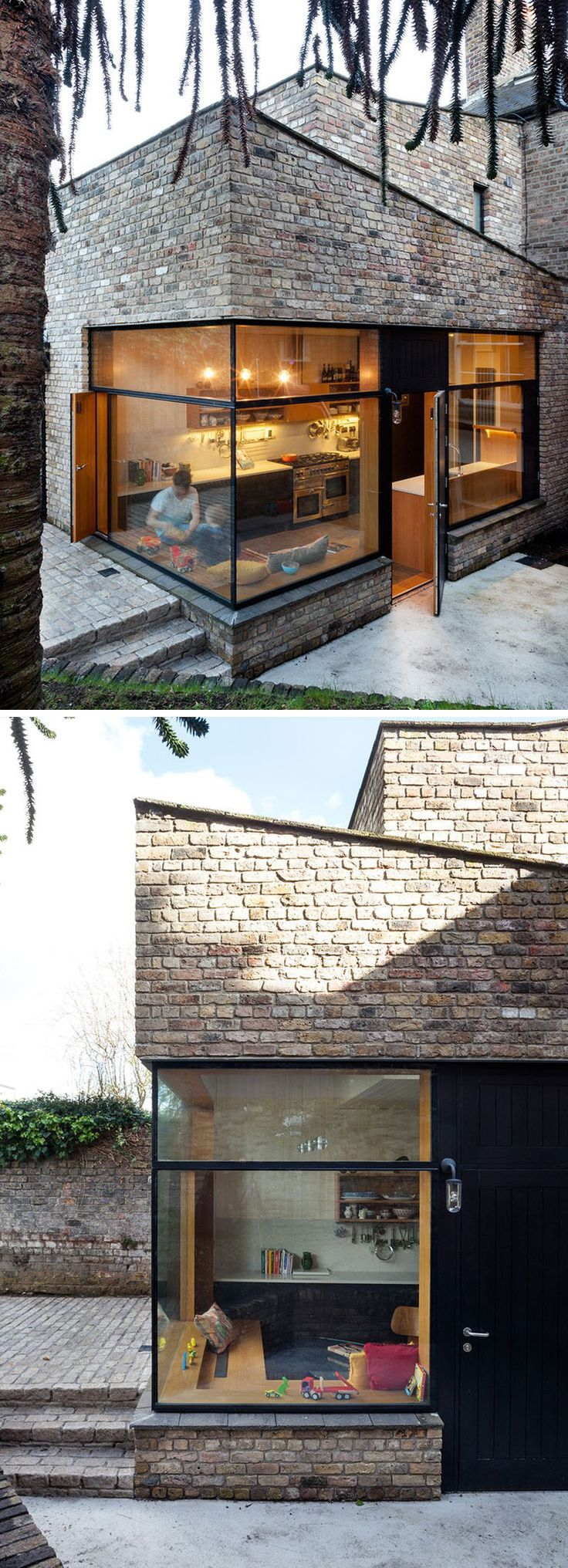 14 Modern Houses Made Of Brick | This brick extension matches the rest of the brick exterior and features large windows to maximize the amount of natural light in the home.