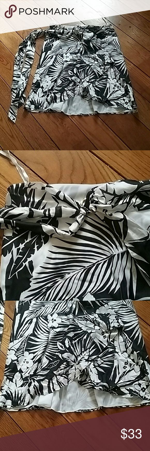 Lauren silk tropical floral skirt Gorgeous, timeless black & white tropical print. EUC. Gold ring holds belt that can be tied or left hanging. Loops for hanging on a hanger to protect the skirt. Shell is 100% silk, Lining 100% polyester Lauren Ralph Lauren Skirts Midi