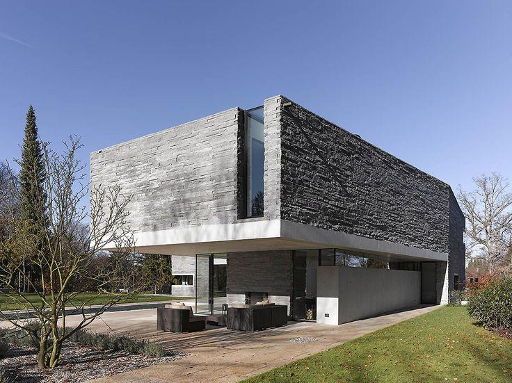 Two-Story House with Rough Stone Facade  House M | DigsDigs | Arquitetura  | Pinterest | Stone facade, Facade house and Facades