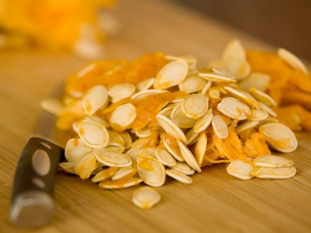 Cheesy Roasted Pumpkin Seeds - it might be fun to make several kinds and put them out in little bowls...