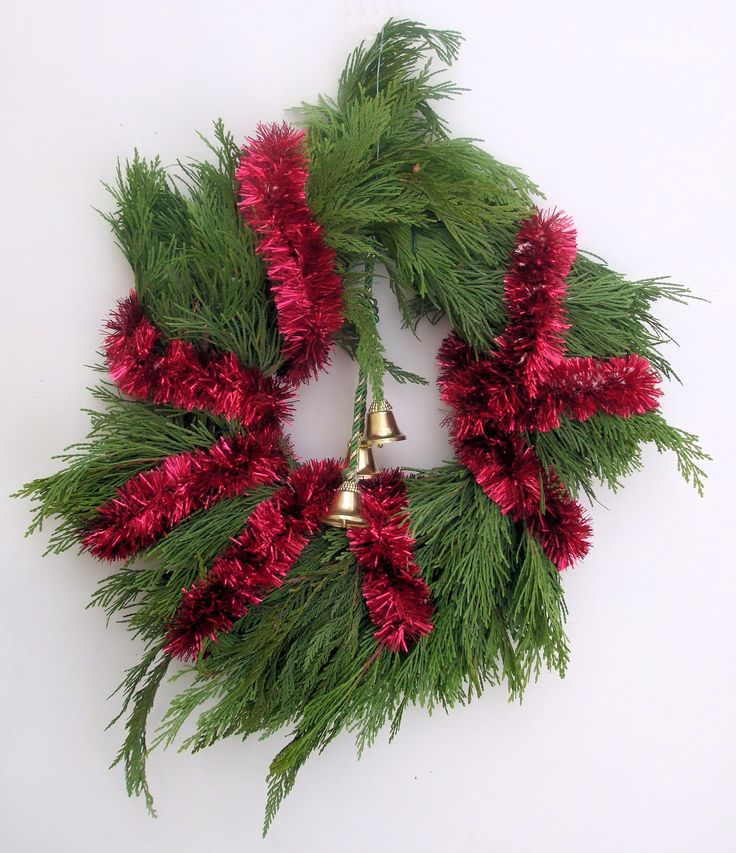"""Christmas Wreath 2:  home-made Christmas wreath of evergreen branches, wrapped with red garland and decorated with three gold bells.  Plain white background. Image size 1875 x 2175px (300ppi); prints at 6.25 x 7.25""""."""