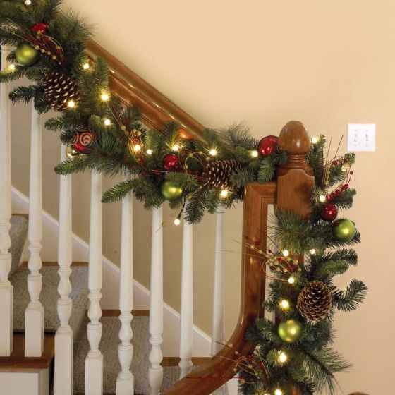 Christmas : 23 Enchanting Pre Lit Christmas Tree And Garland And Wreath Decorations Ideas That You Mus See - Beautiful Pre Lit Christmas Garland Decorated On Staircase With Glossy Green And Red Christmas Balls And Brown Pine Cones And Some Artificial Fruits medium version