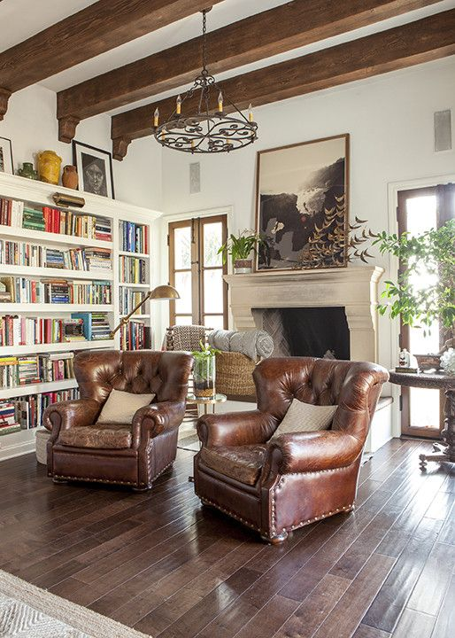 Distressed leather armchairs in a cushy reading nook