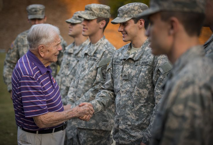 https://flic.kr/p/NMk59B | Skardon greets cadets | Clemson Univeristy professor emeritus, alumnus, and WWII hero Ben Skardon, 99, a survivor of the Bataan Death March, greets ROTC cadets who came to place flags around the Scroll of Honor for Military Appreciation Day, Nov. 3, 2016. (Photo by Ken Scar)