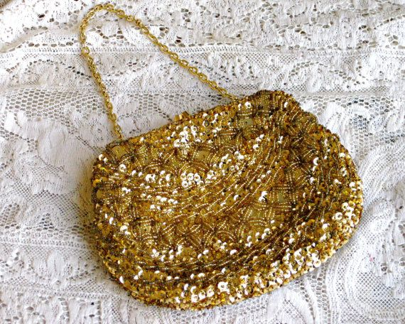 This beautiful beaded and sequined evening purse is the perfect accessory for a wedding, formal, or a holiday party! It is covered in small