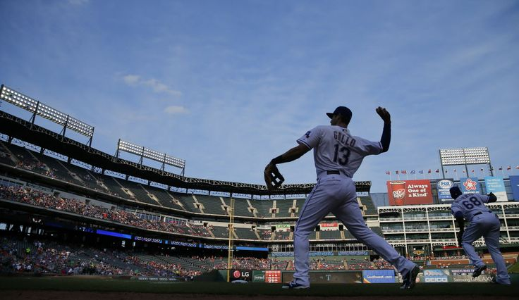 Texas Rangers third baseman Joey Gallo (13) warms up his arm before making his first Major League start against the Chicago White Sox at Globe Life Park in Arlington, Tuesday, June 2, 2015. (Tom Fox/The Dallas Morning News)