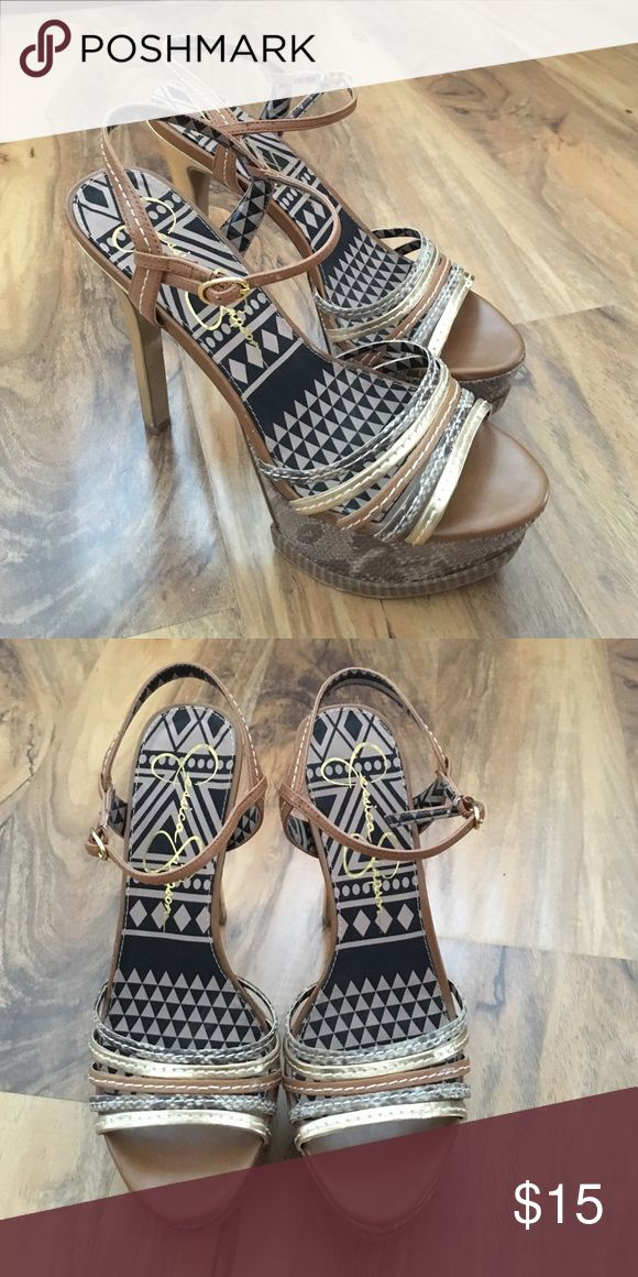Jessica Simpson heels Lightly worn Jessica Simpsons Heels size 7.5 snake skin and tribal designs Jessica Simpson Shoes Heels