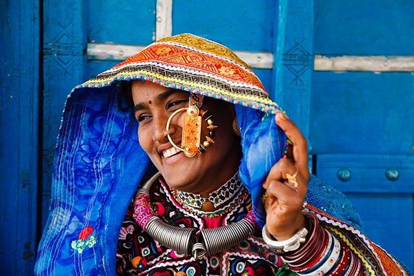 Portrait of a woman from the Marwada Meghwal Harijan tribe wearing traditional clothing and a large golden wedding ring through her nose in the village of Zura, located roughly 30km from Bhuj in the Kutch District