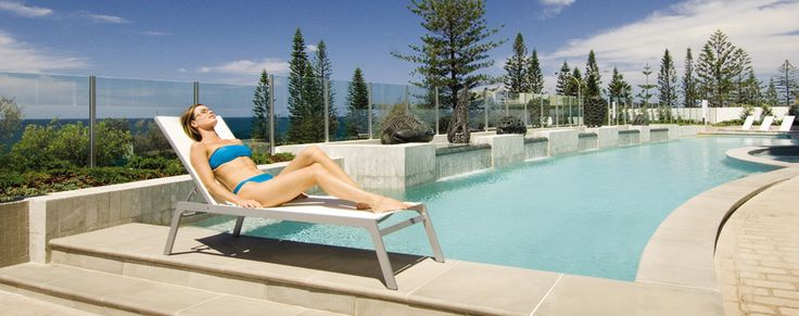 Relaxing by the pool at Oceans Mooloolaba Resort